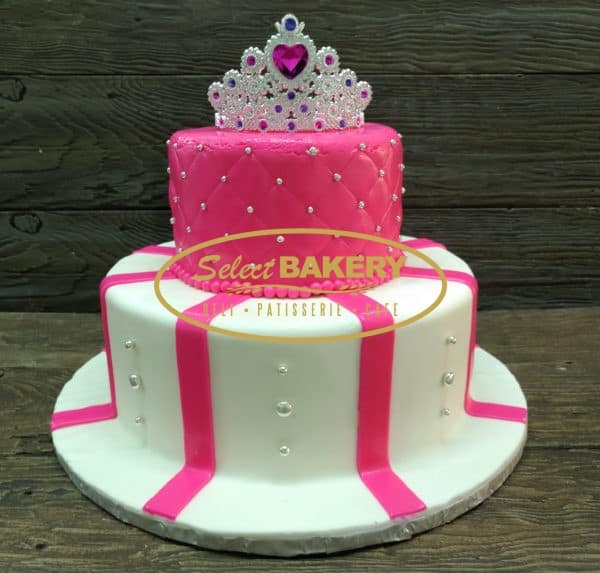 Treat your loved ones like a Princess! 2 tiered cake hand decorated with pink and white fondant and edible silver pearls. The cake includes a tiara cake topper! Please allow us 72 hours for your order!
